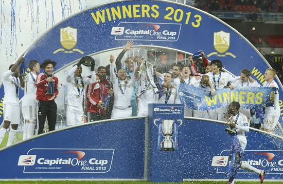 Swansea City players celebrate with the trophy