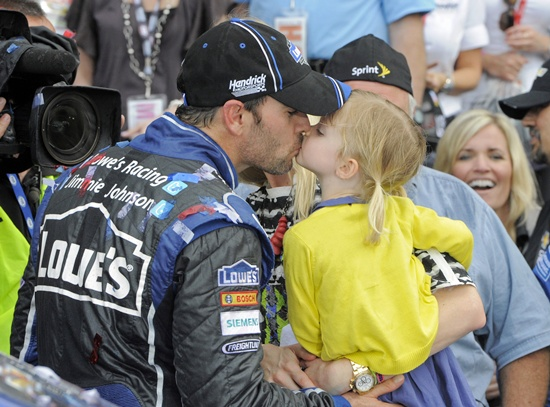 Jimmie Johnson kisses his daughter Genevieve Marie