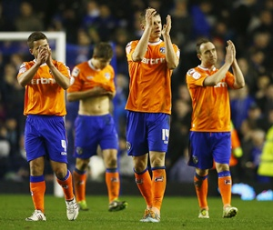 Oldham Athletic's players react after their FA Cup fifth round replay match against Everton