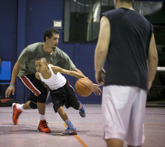 Julian Newman participates in Friday evening pickup basketball games at Downey Christian School in Orlando, Florida