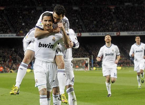 Real Madrid's Cristiano Ronaldo (left) is congratulated by teammate Alvaro Arbeloa