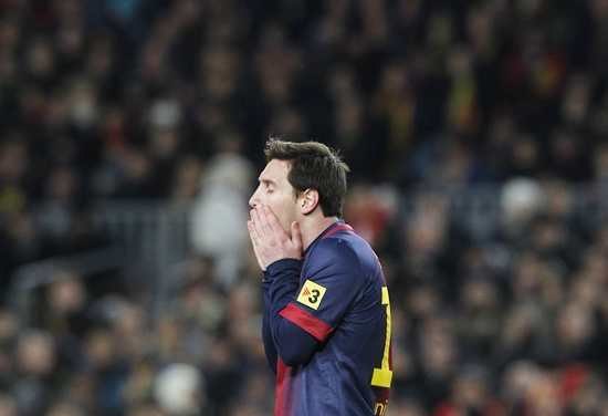 Barcelona's Leonel Messi reacts after missing a chance to score