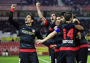 Atletico Madrid's Radamel Falcao (left) celebrates with teammates after scoring against Sevilla during their Spanish King's Cup semi-final second leg match on Wednesday