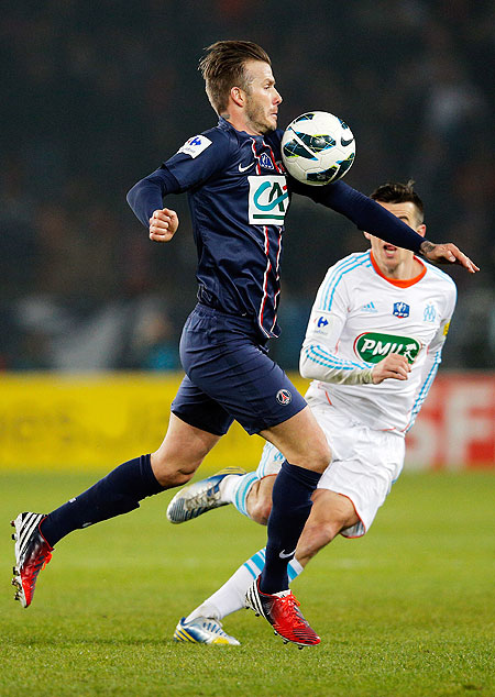 PSG'S David Beckham runs past Marseille's Joey Barton during their Ligue 1 tie on Wednesday