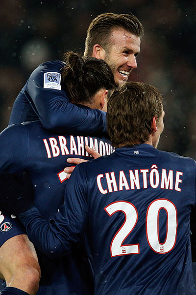 PSG's David Beckham celebrates with teammate Zlatan Ibrahimovic