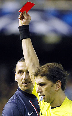 Paris Saint Germain's Zlatan Ibrahimovic (L) reacts as he is shown a red card