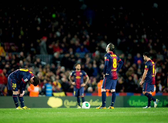 Barcelona players wear a dejected look after losing to Real Madrid