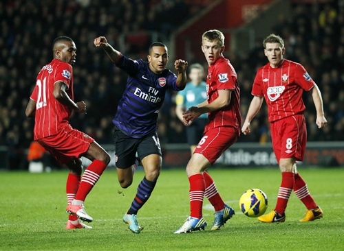 Arsenal's Theo Walcott breaks through the Southampton defence