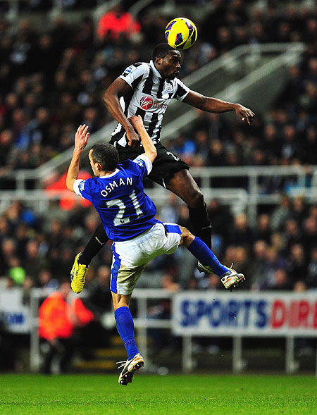 Everton's Leon Osman (left) and Newcastle United's Shola Ameobi during are involved in an aerial duel during their English Premier League match on Wednesday