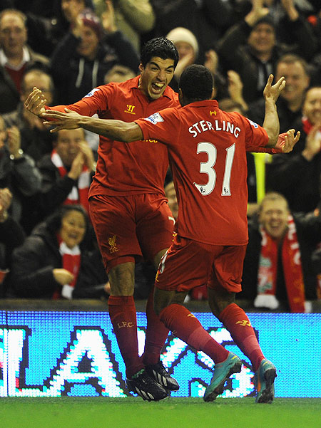 Liverpool's Luis Suarez and Raheem Sterling celebrate after scoring against Sunderland during their English Premier League match on Wednesday