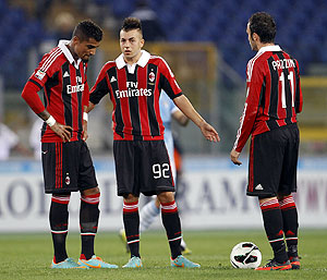 AC Milan's Kevin Prince Boateng, Stephan El Shaarawy and Gianpaolo Pazzini react