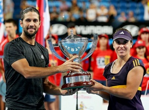Fernando Verdasco and Anabel Medina Garrigues of Spain pose with the trophy