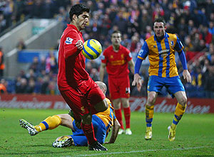 Liverpool's Luis Suarez appears to control the ball with his hand during the FA Cup match against Mansfield Town on Sunday