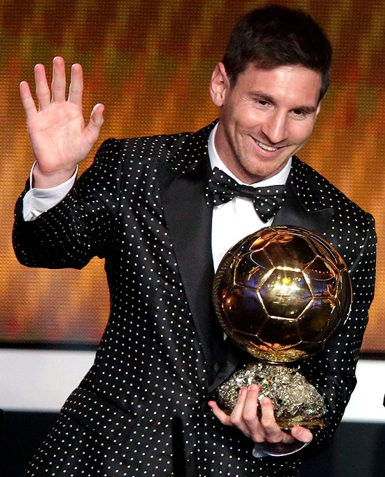 Lionel Messi with the FIFA Ballon d'Or 2012 trophy