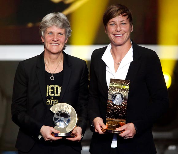 Pia Sundhage (left) with Abby Wambach