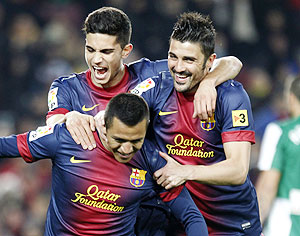 Barcelona's Alexis (centre) celebrates his goal with teammates Marc Bartra and David Villa (right) against Cordoba