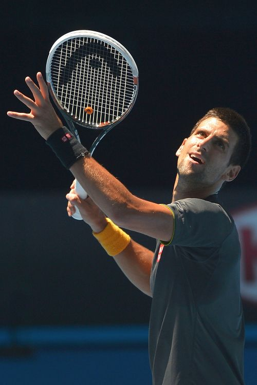Novak Djokovic of Serbia serves during his practice session ahead of the 2013 Australian Open at Melbourne Park