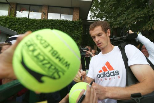 Andy Murray of Great Britain signs autographs for fans