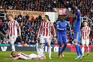 Chelsea's Juan Mata (right) celebrates an own goal from Stoke City's Jonathan Walters (2nd from left) during their English Premier League match at the Britannia Stadium in Stoke-on-Trent, on Saturday