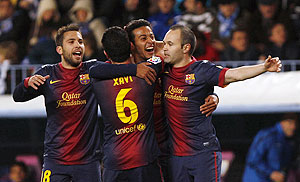 Barcelona players celebrate scoring against Malaga