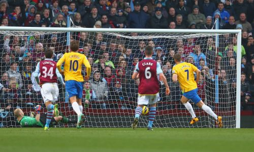 Rickie Lambert of Southampton scores from the penalty spot during the Barclays Premier League match between Aston Villa and Southampton