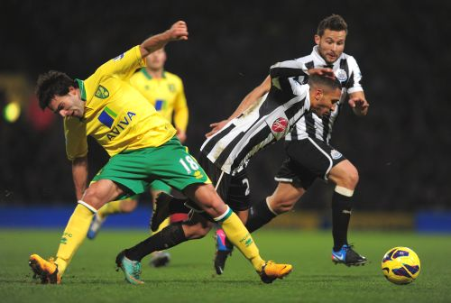Sylvain Marveaux of Newcastle United battles with Javier Garrido of Norwich City during the Barclays Premier League match between Norwich City and Newcastle United
