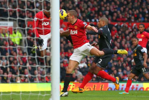 Nemanja Vidic of Manchester United scores the second goal from a deflected Patrice Evra header during the Barclays Premier League match between Manchester United and Liverpool