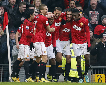 Manchester United's Patrice Evra (centre) celebrates his goal with teammates after scoring against Liverpool