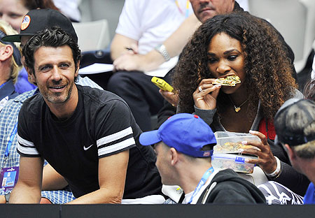 Serena Williams and boyfriend Patrick Mouratoglou (left) watch Venus Williams in action on Monday