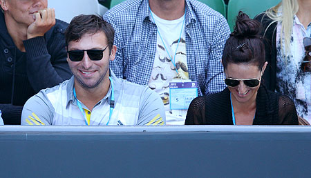 Former Australian Olympic swimmer Ian Thorpe (left) watches the match between compatriot Samantha Stosur and  Chang Kai-chen of Taiwan on Monday