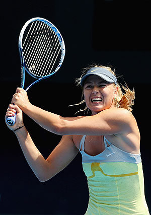 Maria Sharapova of Russia plays a backhand against Olga Puchklova at the Australian Open on Mnday