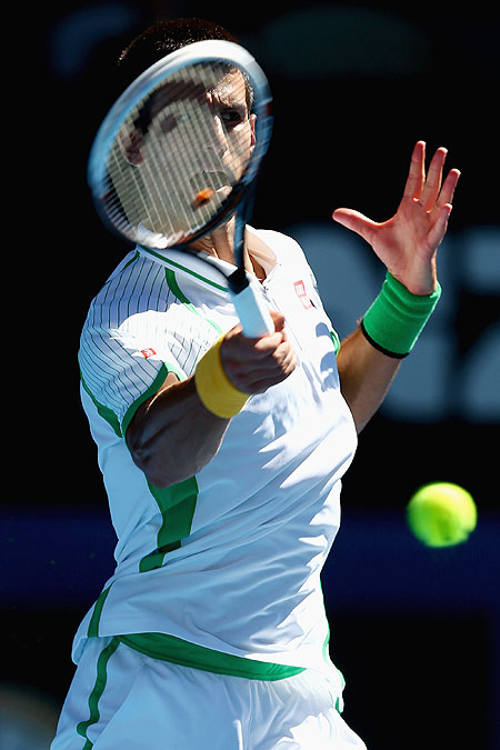Serbia's Novak Djokovic in action against Paul-Henri Mathieu of France