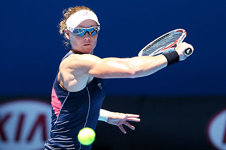 Samantha Stosur of Australia plays a backhand against Kai-Chen Chang of Chinese Taipei