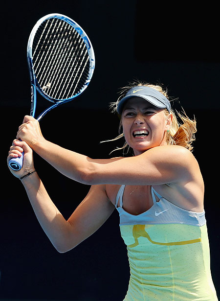 Maria Sharapova plays a returns against compatriot Olga Puchkova