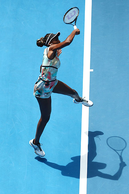 Venus Williams plays a forehand against Galina Voskoboeva of Kazakhstan