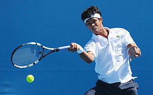 Somdev Devvarman of India plays a forehand in his first round match against Bjorn Phau of Germany