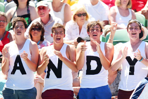 Supporters watch Andy Murray of Great Britain