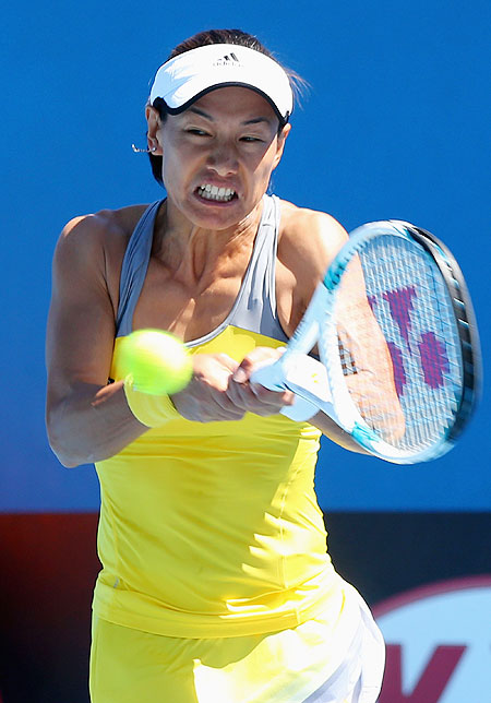 Kimiko Date-Krumm of Japan plays a backhand in her first round match against Nadia Petrova of Russia