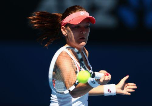 Agnieszka Radwanska of Poland plays a forehand in her second round match against Irina-Camelia Begu of Romania