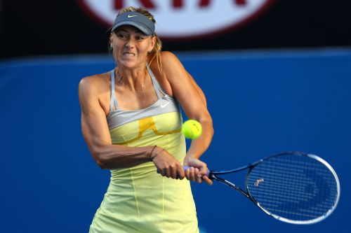Maria Sharapova of Russia plays a backhand in her second round match against Misaki Doi of Japan