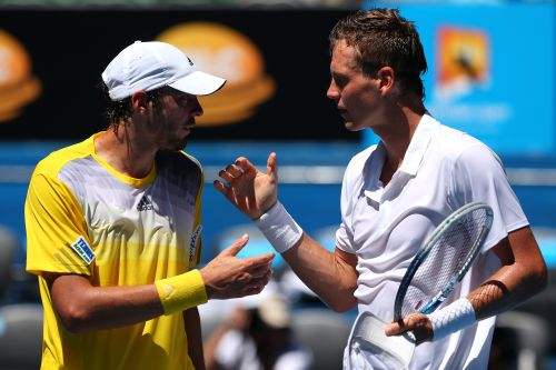 Tomas Berdych (R) of the Czech Republic shakes hands with Guillaume Rufin of France