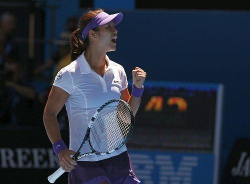 Li Na of China celebrates defeating Olga Govortsova of Belarus in their women's singles match at the Australian Open