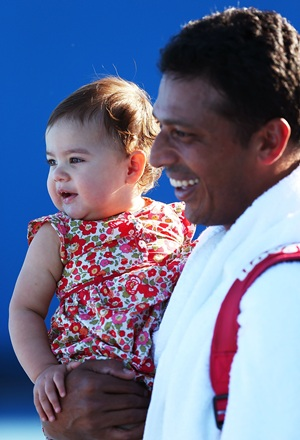 Bhupathi with his daughter at the Australian Open