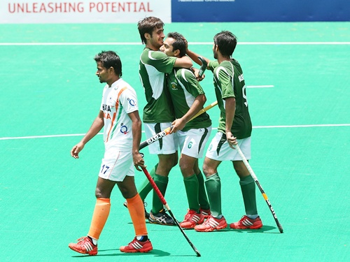 Pakistan hockey players celebrate a goal