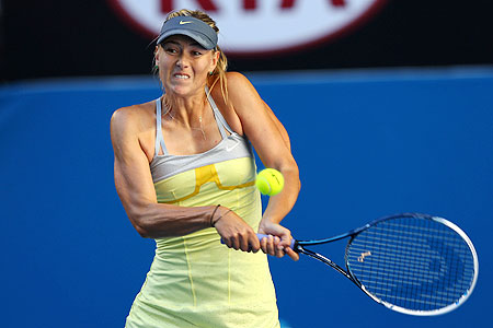 Maria Sharapova plays a backhand in her second round match against Misaki Doi of Japan on Wednesday