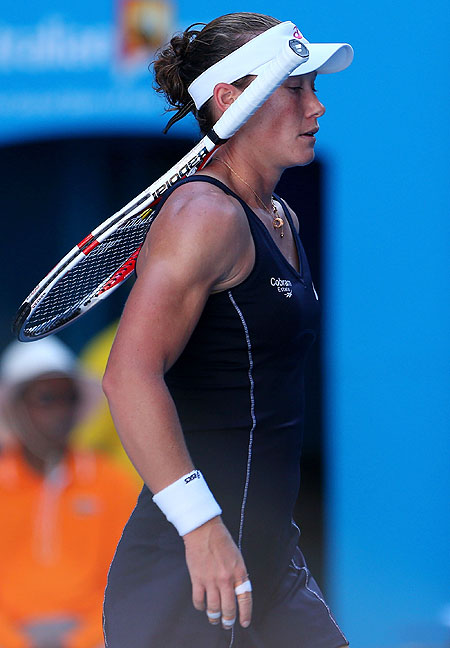 Sam Stosur walks to the net after losing her second round match against Jie Zheng of China