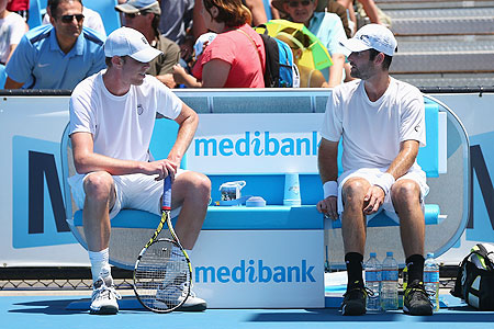 Sam Querrey of the of the US talks to compatriot Brian Baker after the latter retired from the second round match on Wednesday
