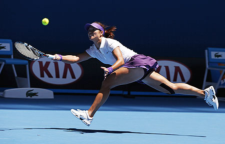Li Na hits a return to Olga Govortsova of Belarus during their women's singles match on Wednesday