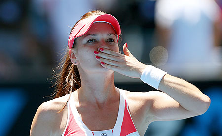 Agnieszka Radwanska of Poland celebrates winning her second round match against Irina-Camelia Begu of Romania