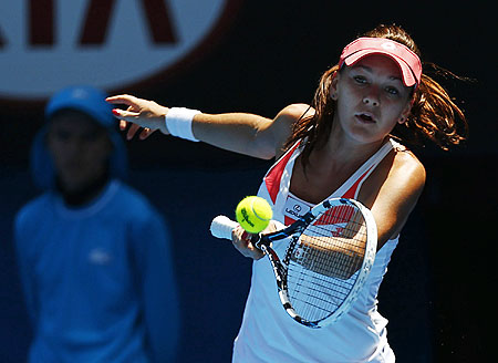 Agnieszka Radwanska of Poland hits a return to Irina-Camelia Begu of Romania